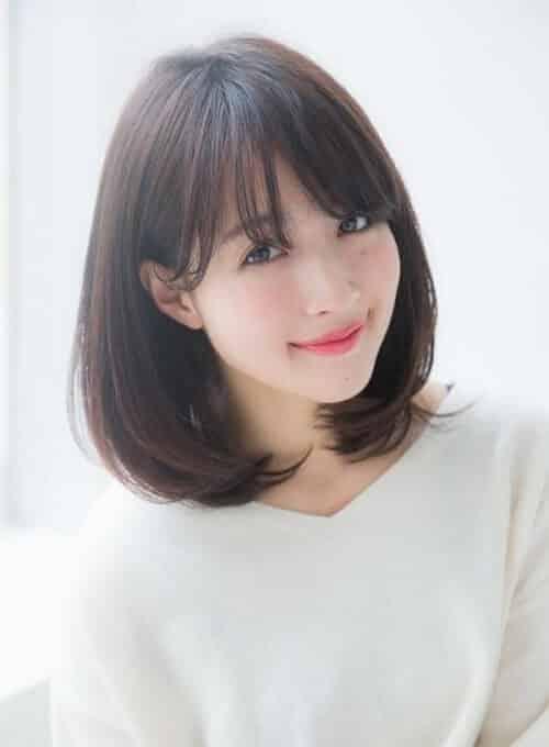 Kiểu tóc ngắn uốn cụp phổ biến