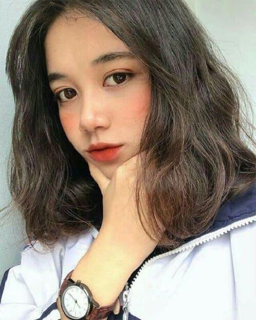 Tóc ngắn xoăn cho mặt dài