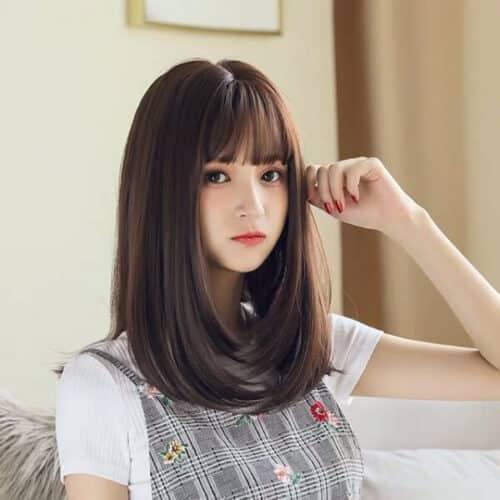 Phần đuôi tóc layer được uốn cúp mang vẻ ngọt ngào không kém phần trẻ trung