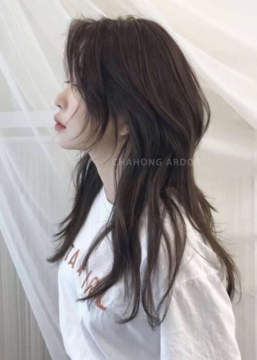 Tóc uốn layer ngang lưng xoăn nhẹ